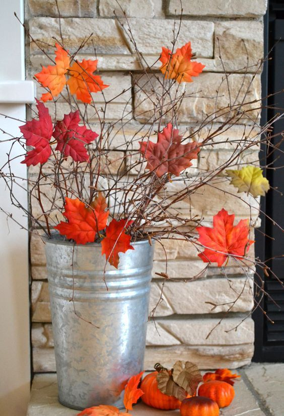 a tin bucket with twigs and branches and with bright fall leaves is a gorgeous and very easy fall decoration