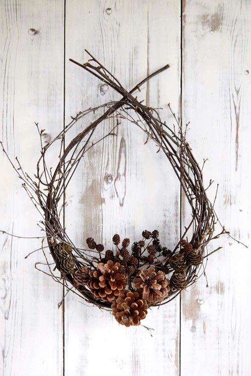 a fall twig wreath with lots of pinecones of various sizes is a gorgeous idea to rock for outdoors