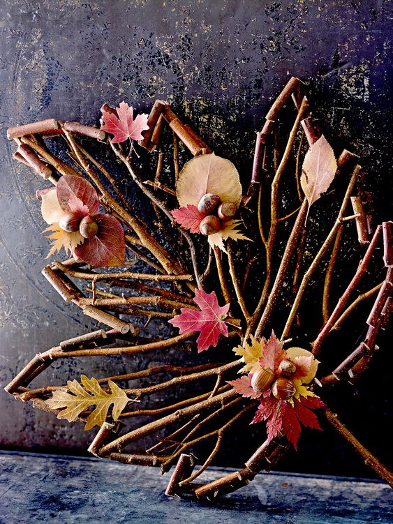 a stick and twig leaf with leaves and acorns is a lovely and easy fall decoration you can make