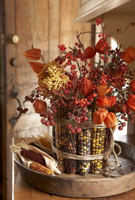 berries, dried blooms with corn cobs covering the vase is a beautiful and all-natural fall centerpiece