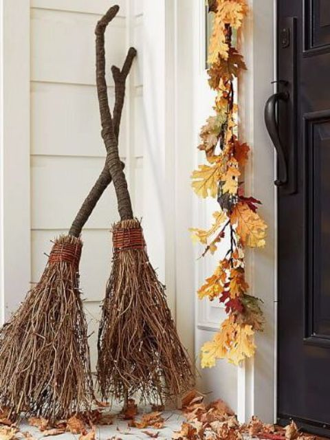 brooms made with twigs can be a nice decoration for Halloween and they are easy to make