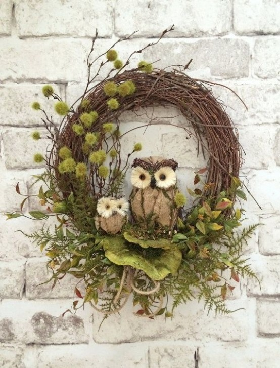 a fall woodland wreath of vine with twigs, greenery, faux leaves and owls is a nice nature-inspired decoration