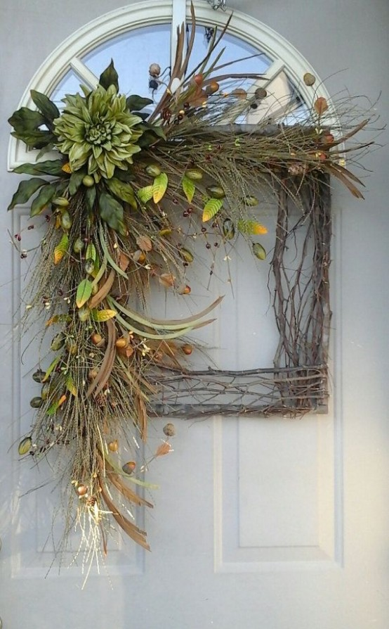 a lush fall wreath of vine, twigs, faux greenery, berries, leaves and blooms is a cool and long-lasting decoration for the fall