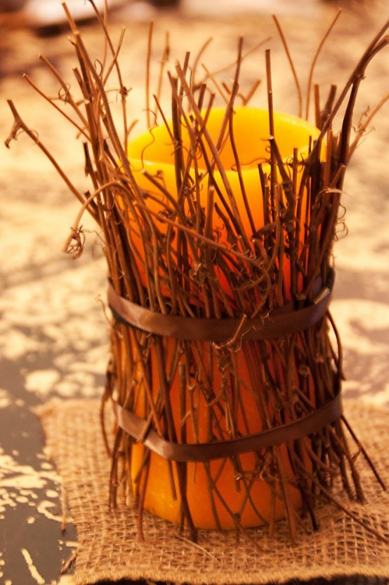a candle covered with twigs is an easy last minute craft for the fall, it looks woodland-like and natural