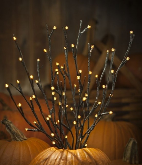 a pumpkin with light up twigs is a cool and easy fall decoration you can make anytime