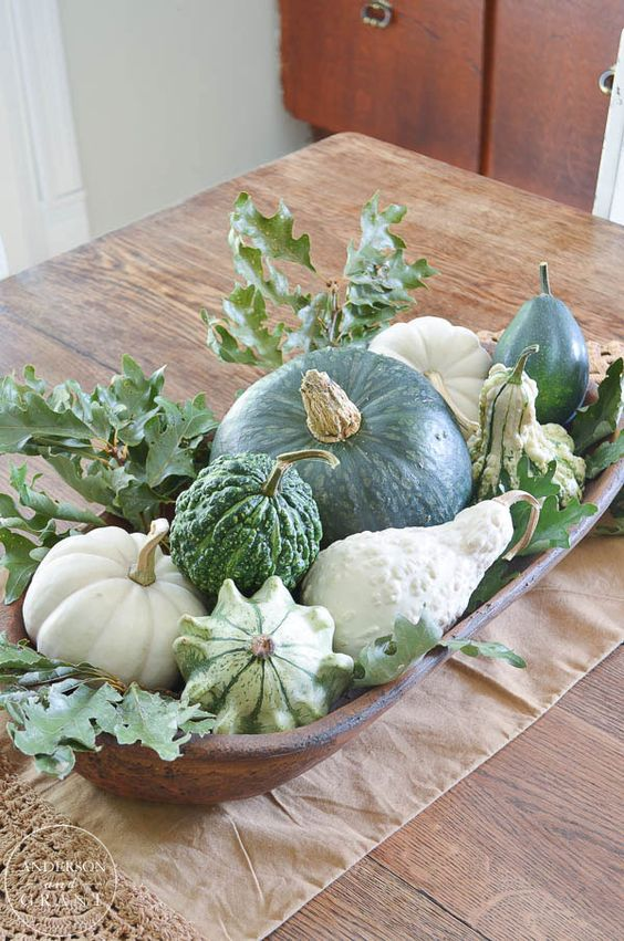 a wooden bowl with gourds and pumpkins, greenery is a simple and lovely fall centerpiece to go for