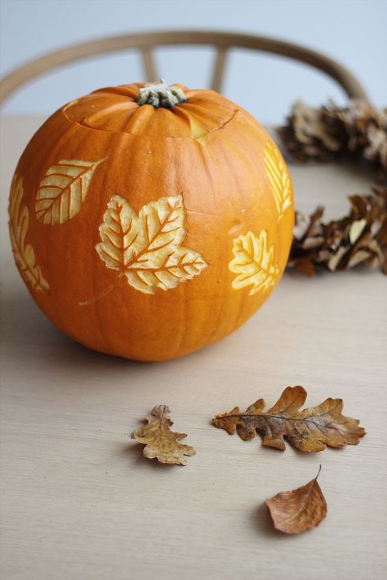 a pumpkin with carved leaves is a beautiful all-natural fall decoration you can make yourself