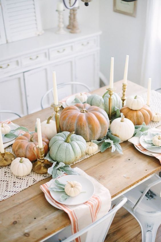 chalked pumpkins, leaves and candles plus a macrame table runner make very neutral and chic fall table decor