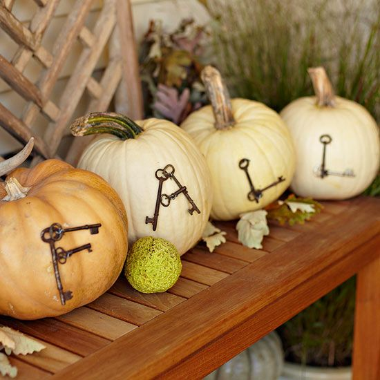 natural pumpkins with letters made of vintage keys are a cool fall decoration for indoors or outdoors