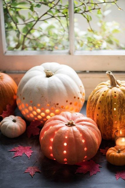 perforated pumpkin in various natural colors and with candles inside are very chic and very cozy for fall decor