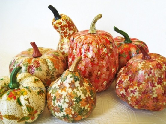 pumpkins and gourds decoupaged with bright fall leaves and blooms look fun and very out of the box
