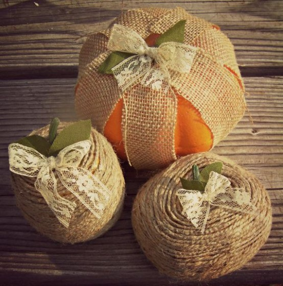 wrap some real pumpkins with burlap and add a lace bow on top to make them look stylish and very rustic