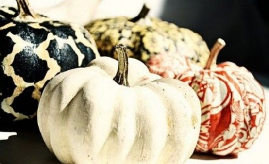 mini pumpkins with bright patterns, swirls in various fall colors are a cool DIY to go for