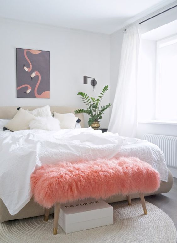 a pink faux fur bench adds color to the space and brings much texture to it making it more welcoming