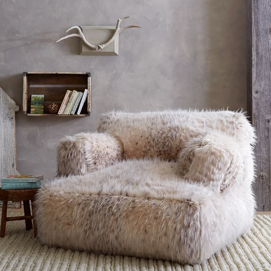 a fuzzy faux fur oversized chair or lounger is amazing to relax in it after a long day