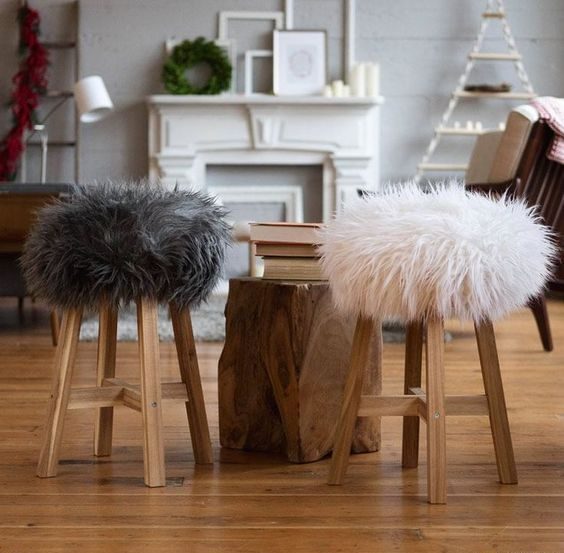 wooden stools with faux fur covers are very cozy and very welcoming during cold months