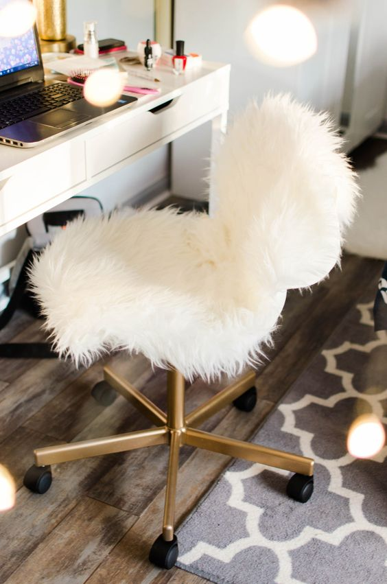 a white faux fur and gold chair with casters is a nice piece for a home office or a makeup space