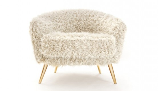 a grey faux fur chair on gold legs is a chic and cozy furniture piece to rock in any space