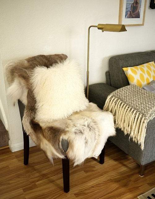a usual chair covered with faux fur adds coziness to the space and invites you to sit on it and relax