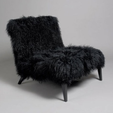 a black faux fur loveseat is a cool piece for a Gothic-infused interior or just a moody space