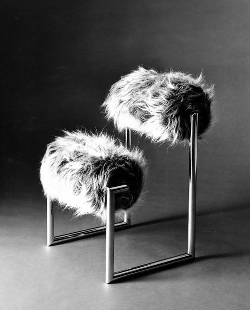 a catchy chair made of metal framing and two faux fur rollers is a bold and chic idea for a modern space