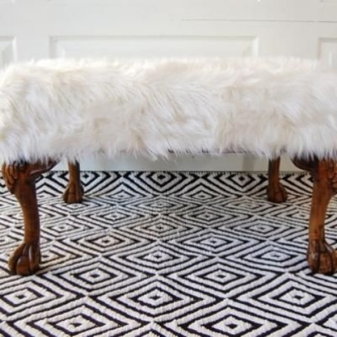 a refined white faux fur bench with animal legs is a quirky and fun glam piece for a modern space