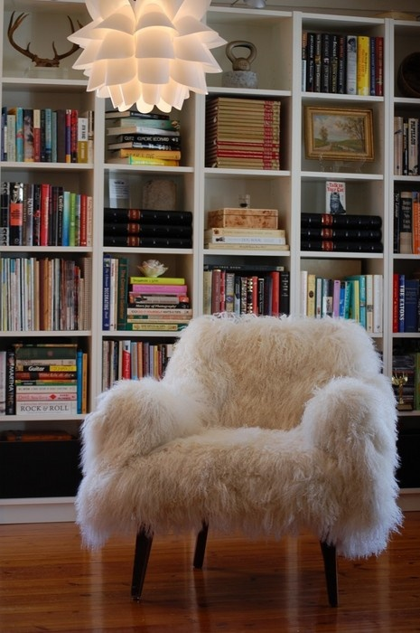 a white faux fur chair is an ultimate piece for a reading nook or a library, it's amazing to read on it