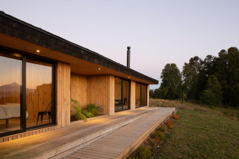 The wooden deck that links the bedrooms is gradually lowered until it become flush with the garden