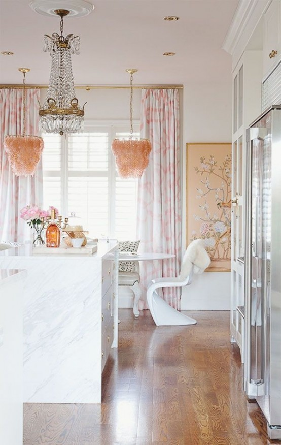 A Glam Girlish Kitchen With White Cabinetry, Marble And Stone Countertops, A Crystal And Pink Feather Chandeliers And Shiny Metal Touches