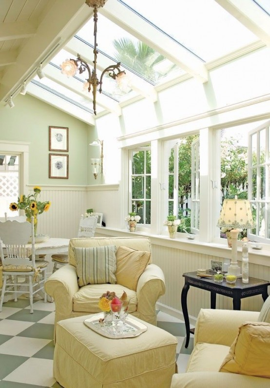 a neutral vintage sunroom with elegant and refined furniture in pastels, pendant lamps, lamps on the tables and much light