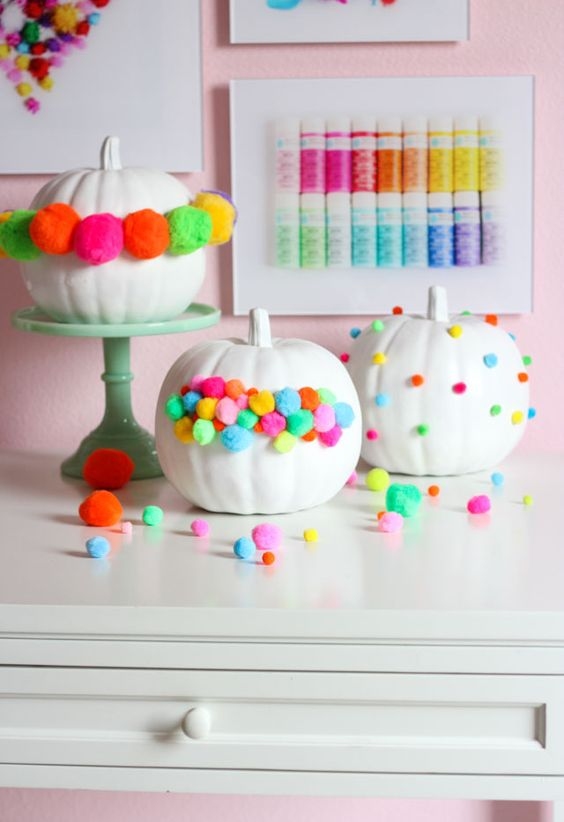 colorful pompom pumpkins will easily fit Halloween, fall and Thanksgiving parties in bold shades