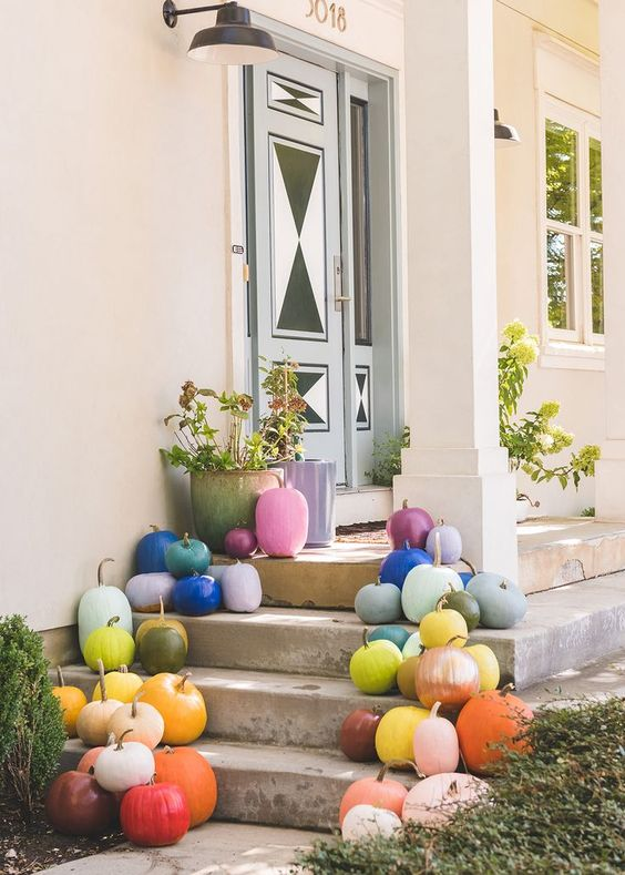 colorful pumpkins with gilded stems put on steps are amazing for fall and Halloween decor