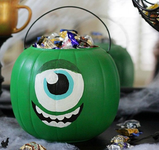 a green pumpkin monster filled with candies is inspired by Monster Corporation and looks super cool