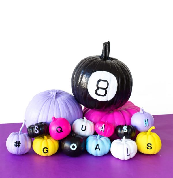 colorful and neon pumpkins with various decor and letters for a bright Halloween party