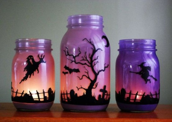 ombre pink and purple jars with scary scenes made with black paper and candles are easy and stylish Halloween decorations