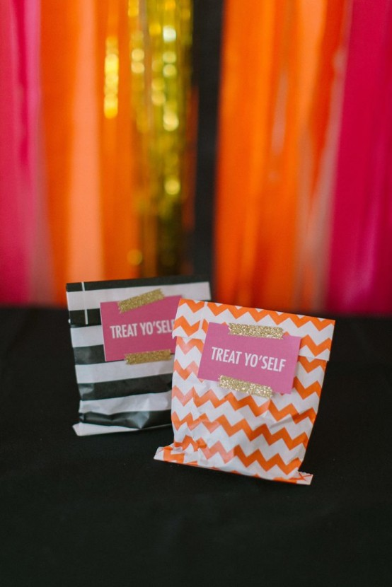 colorful and printed paper bags with candies as party favors or treats for tick-o-treaters