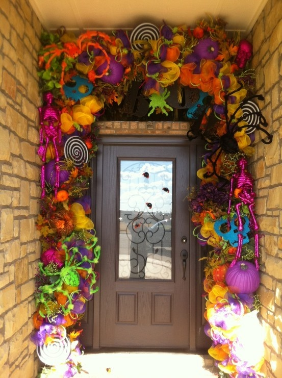 crazy colorful entrnace styling in bold colors, with ribbons, pops, skeletons, pumpkins, spiders and skulls