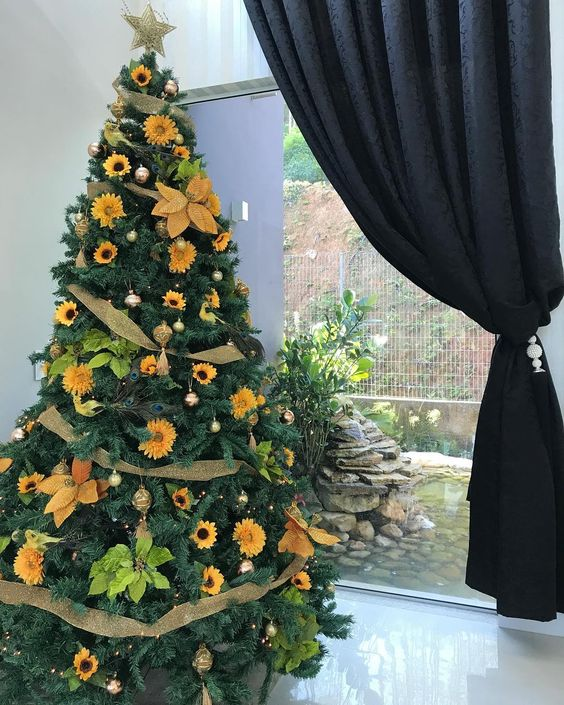 a cozy Thanksgiving tree decorated with lights, pinecones, faux sunflowers and faux white blooms plus burlap ribbons