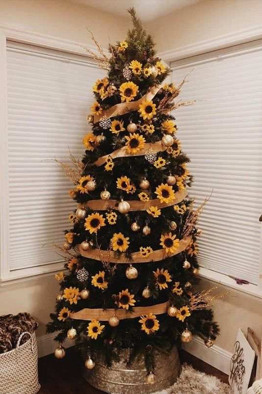 a stylish Thanksgiving tree with faux sunflowers, gold ornaments and branches plus burlap ribbons