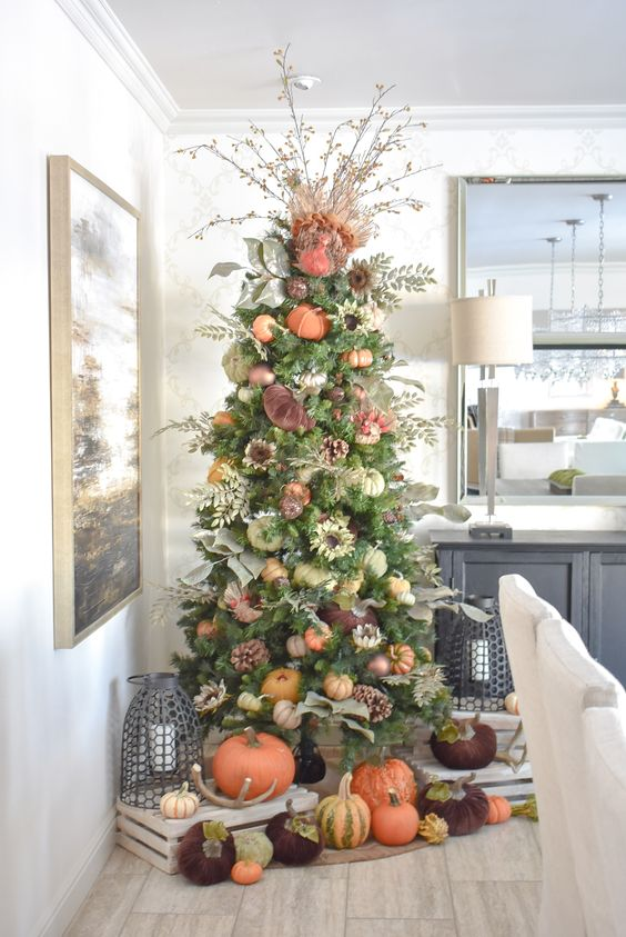 a bright and natural-looking Thanksgiving tree with various pumpkins, pinecones, faux flowers and branches