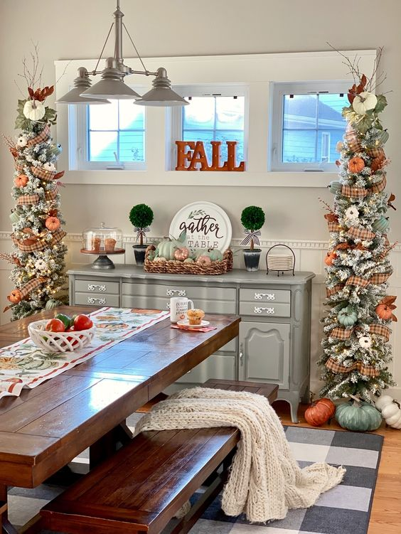 two pretty rustic Thanksgiving trees with lights, plaid ribbons, orange and green pumpkins and branches