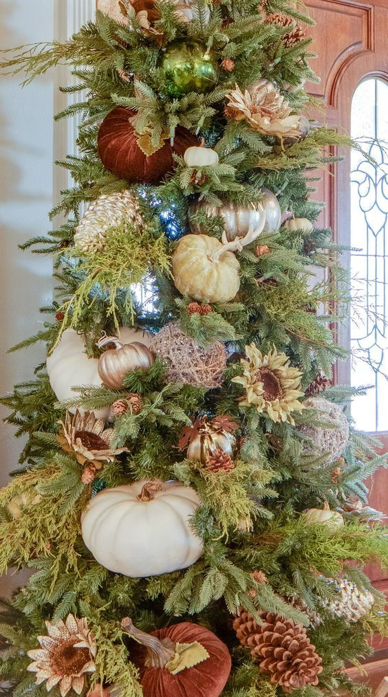 a gorgeous fall or Thanksgiving tree with large faux and velvet pumpkins, blooms, lights and metallic yarn balls