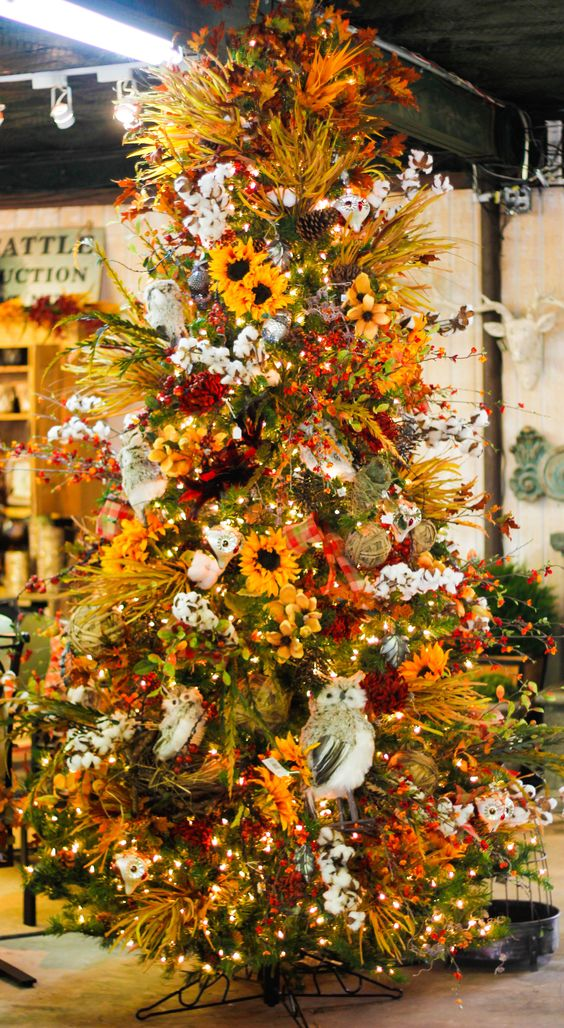 a bright fall to Thanksgiving tree with lights, cotton, faux blooms, greenery and branches plus pinecones is wow