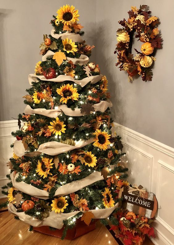 a stylish rustic Thanksgiving tree with burlap ribbons, lights, faux pumpkins and blooms, a matching wreath