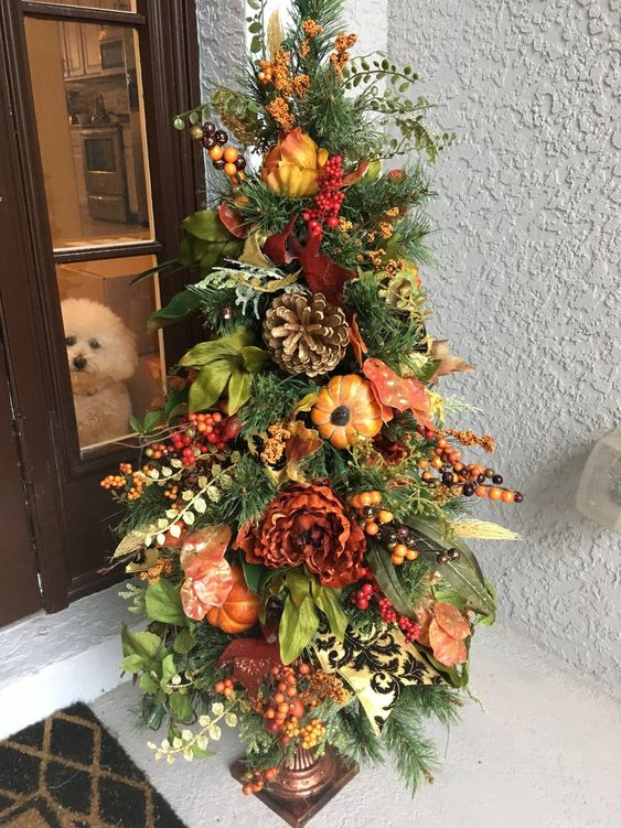 a fall tree with leaves, greenery, berries, bright blooms is a great outdoor decoration for Thanksgiving