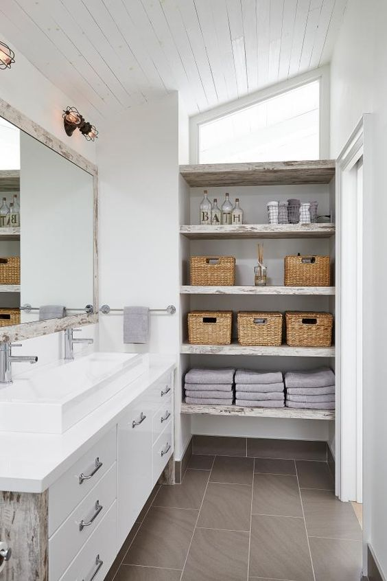 a neutral shabby chic bathroom with shabby chic open shelves on one side that give plenty of storage space