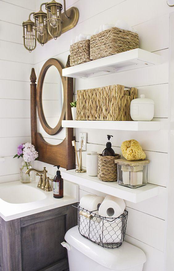 classic open bathroom shelving over the toilet are an elegant idea for a rustic or farmhouse bathroom