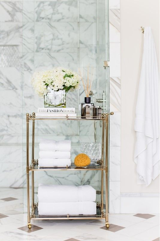a refined gold and glass rolling cart is a gorgeous option for a sophisticated and chic bathroom