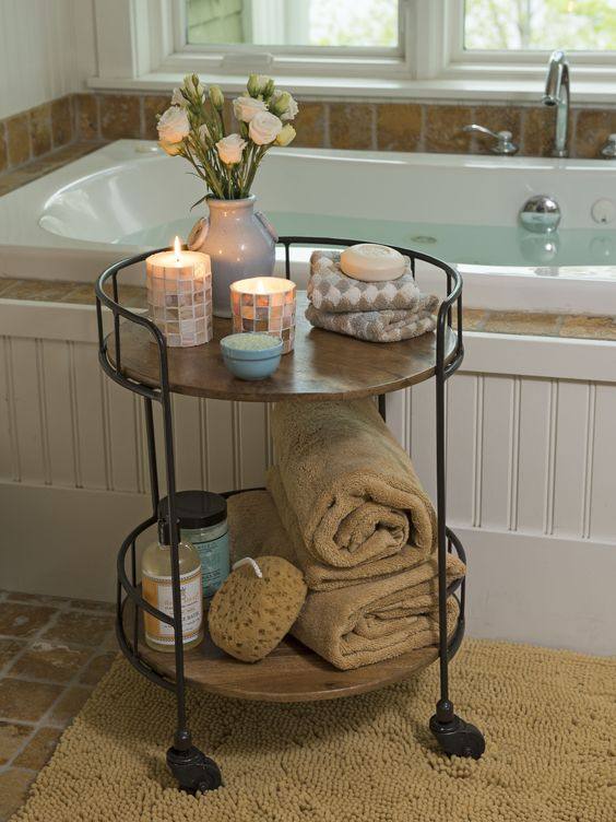 a rustic rolling cart of blackened steel and wooden tiers is a stylish idea for a rustic or vintage space