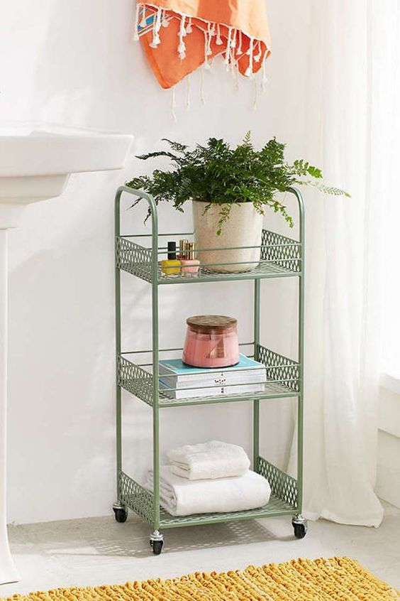 a vintage green rolling cart is a nice splash of color and a chic item for a cool look